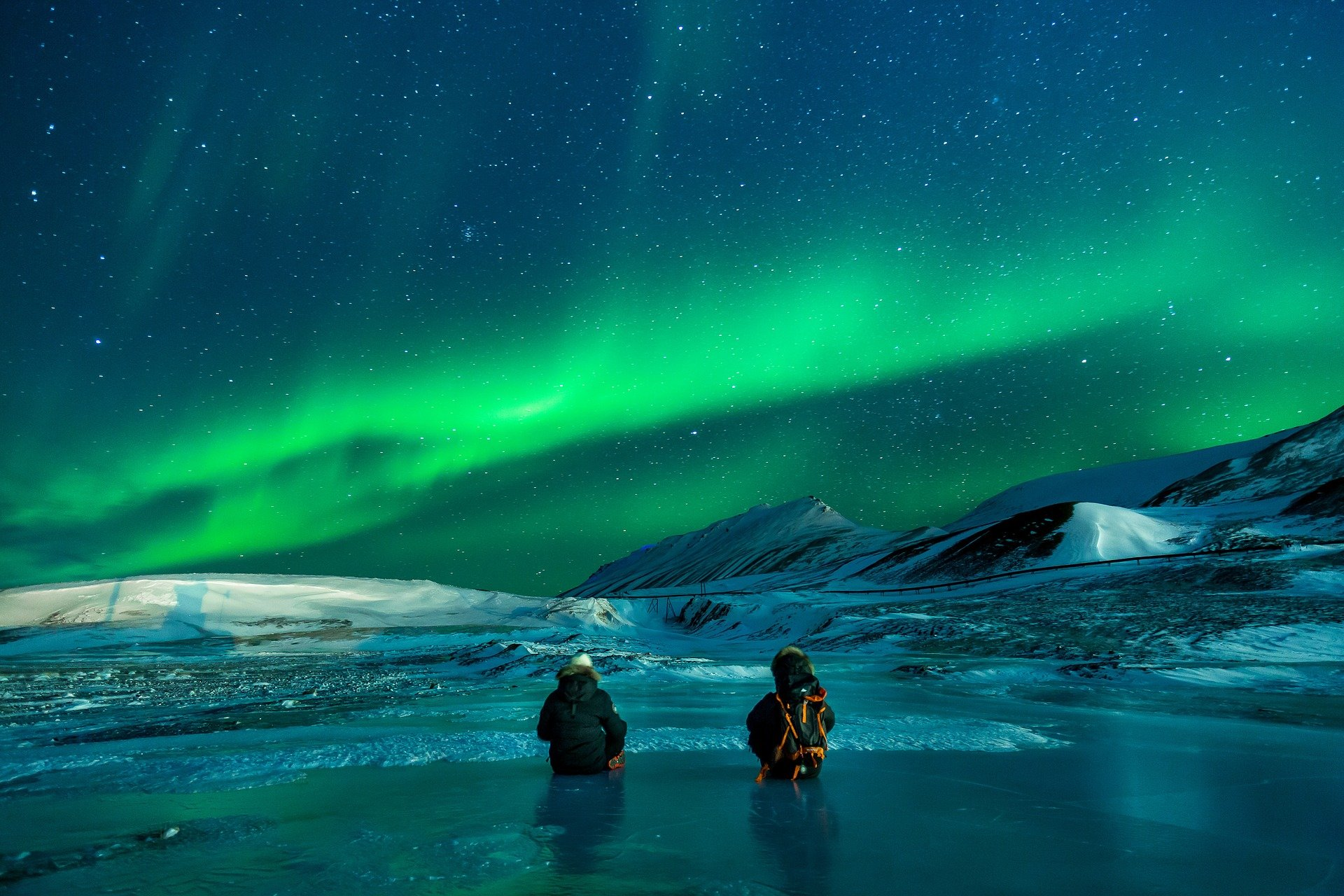 nordlichter sehen grün schneelandschaft