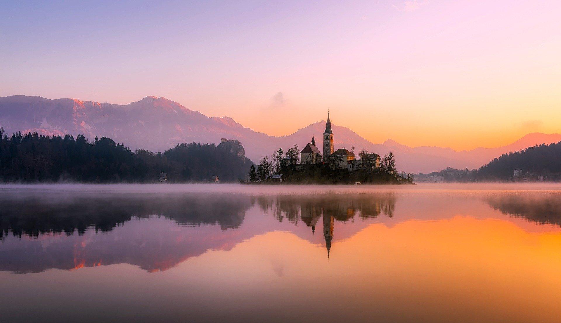 Slowenien Urlaub - Gewässer, Sonnenuntergang, Kirche